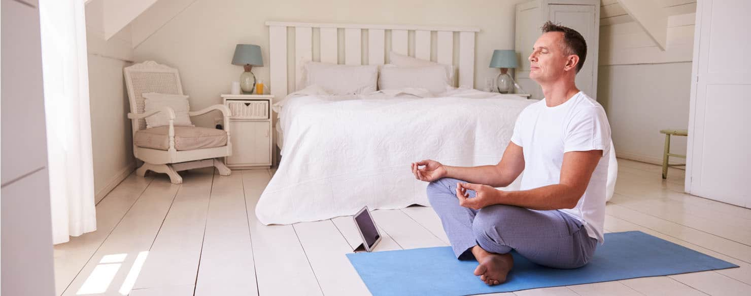 what is an erection? men doing yoga in the bedroom - banner